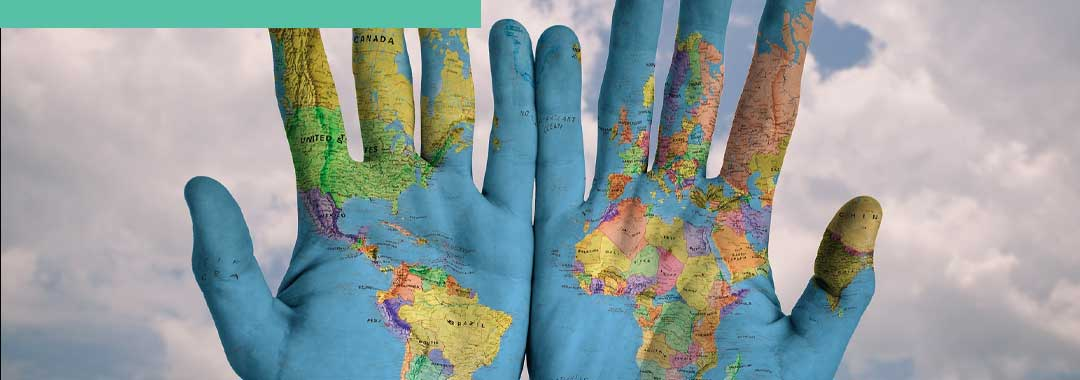 World map in your hands as a sustainable consumer